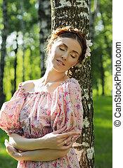 Young beautiful woman in the garden - Young beautiful woman ...