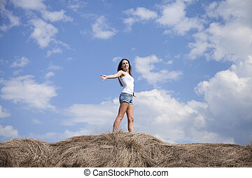 Young beautiful woman in the hayloft in the village - Young...