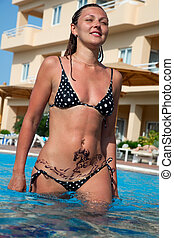 young beautiful woman in the pool