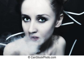 young beautiful woman in the smoke