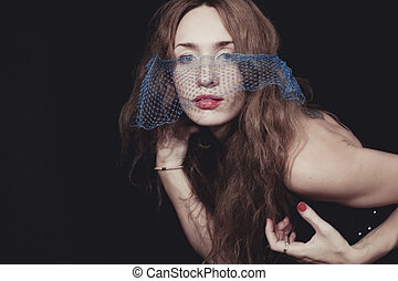Young beautiful woman in the veil.