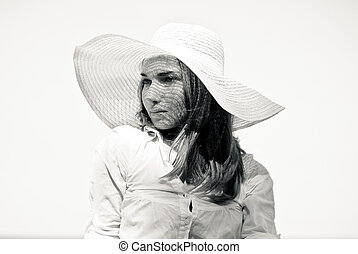Young beautiful woman in white beach hat portrait