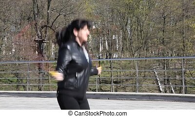 young beautiful woman jumping rope