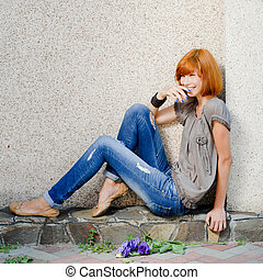 Young beautiful woman laughing happilly
