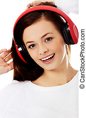 Young beautiful woman listen the music