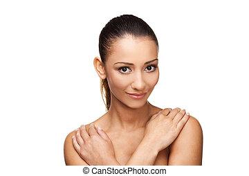 Young beautiful woman looking at camera