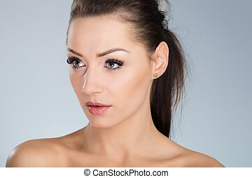 Young beautiful woman looking away
