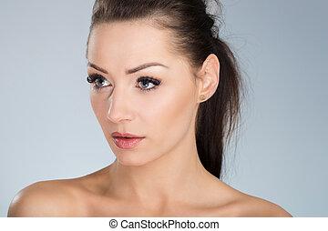 Young beautiful woman looking away