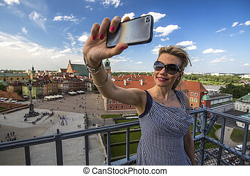 woman making selfie with smartphone