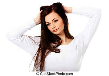 Young beautiful woman massaging her own hairs