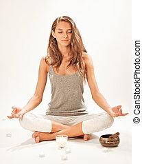 Young beautiful woman meditating in lotus pose