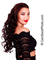 Young beautiful woman model with long hair wears evening black dress