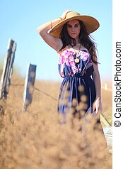 Young Beautiful Woman on a Field in Summer Time - Beautiful...