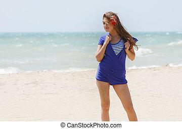 young beautiful woman on beach