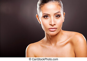 young beautiful woman on black background