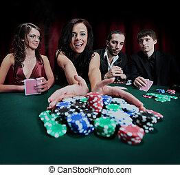 young beautiful woman playing in casino.