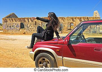 Young beautiful woman pointing far - Young beautiful woman...