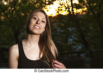 Young beautiful woman portrait sunset