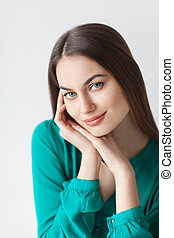 Young beautiful woman portrait with healthy face skin