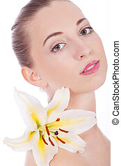 young beautiful woman portrait with white flower