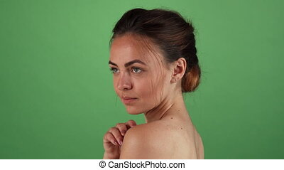 Young beautiful woman posing elegantly on chromakey