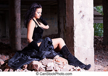 woman posing in ruins after fire