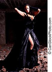 woman posing in ruins