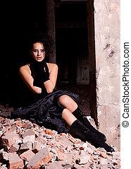 beautiful woman posing in ruins
