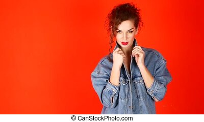 Young beautiful woman posing in studio. The concept of youth.