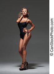 Young beautiful woman posing in underwear