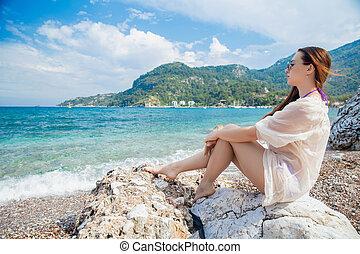 Young beautiful woman posing sitting