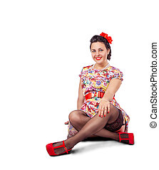 young beautiful woman posing while sitting on the floor