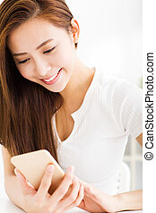 young beautiful woman reading message on the smart phone