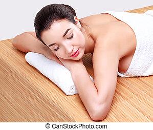 Young beautiful woman relaxing at spa salon