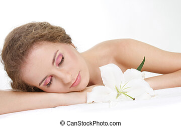 young beautiful woman relaxing over white