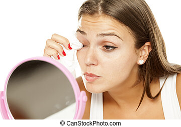 woman removing makeup - young beautiful woman removing ...