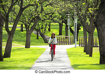beautiful woman riding a bicycle
