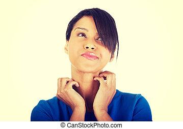 Young beautiful woman scratching her self.