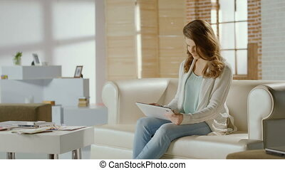 Young beautiful woman shopping online on tablet, ordering goods