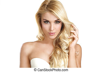 young beautiful woman showing her blonde hair on white