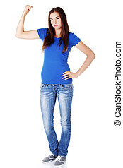 Young beautiful woman showing her strenght and muscle.