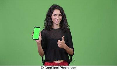 Young beautiful woman showing phone