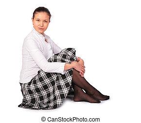 young beautiful woman sits