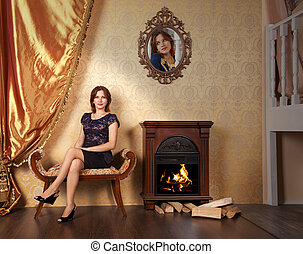 young beautiful woman sitting on a couch in the room