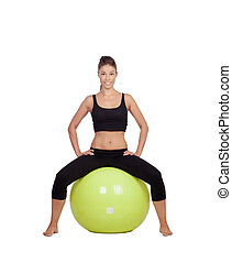 Young beautiful woman sitting on a gymnastic ball