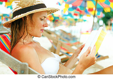 Beautiful nude woman reading a book #11
