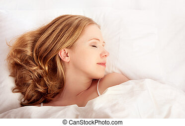 beautiful woman sleeping in white bed net