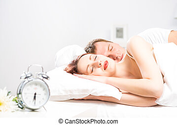 beautiful woman sleeping on the bed - young beautiful woman...