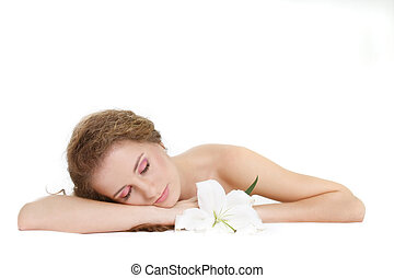young beautiful woman sleeping over white