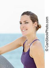 young beautiful woman smiling at camera